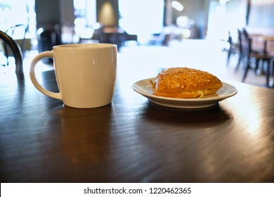 Fiesta Sandwich and Americano coffee on wooden table. A cup of American coffee