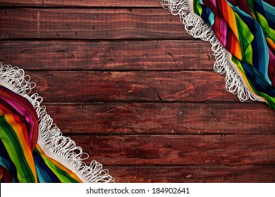 Fiesta: Wooden Background with Colorful Serape Border