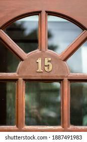 Fifteen in metal digits on a front door