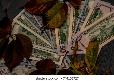 Fifteen and one hundred dollar bills are placed as background.