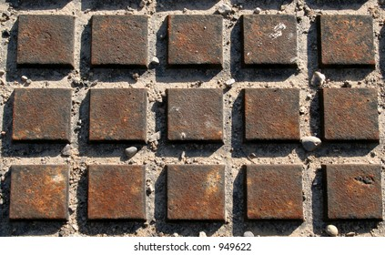 Fifteen rusted squares.