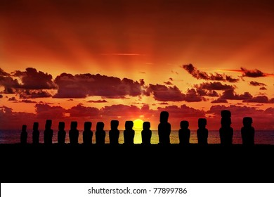 Fifteen silhouettes of standing moai at sunset in Easter Island