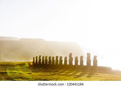 Fifteen standing moai at sunrise in Easter Island in morning mist