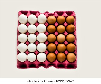 Fifteen white and fifteen brown eggs in pink cardboard egg box on the white ground.Thirty eggs close up taken,isolated,top view.