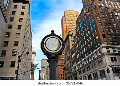 The Fifth Avenue building in New York City and big clock, USA
