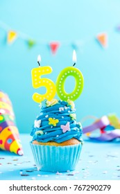 Fiftieth 50th birthday cupcake with candle and sprinkles. Card mockup.