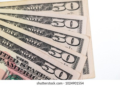 Fifty 50 dollar bills shot against a white background