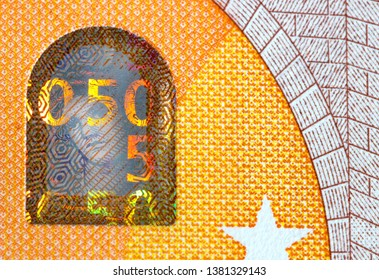 fifty euro bank note with hologram, finance currency detail background