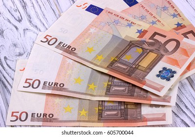 Fifty euro banknotes on white wooden background
