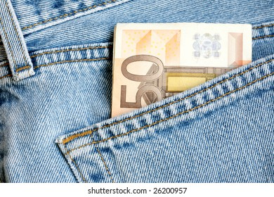 Fifty euro bill sticking out from a blue jean pocket.