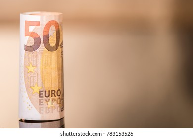 fifty euro rolled up bank note