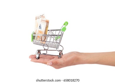 Fifty euro in the shopping pushcart on the hand, isolated on white