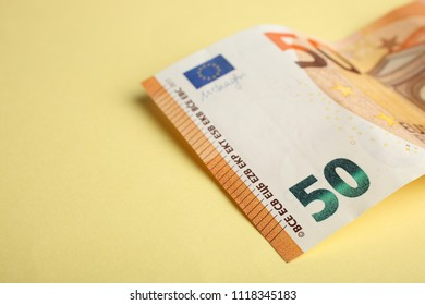 Fifty euros are on an orange background. Side view.