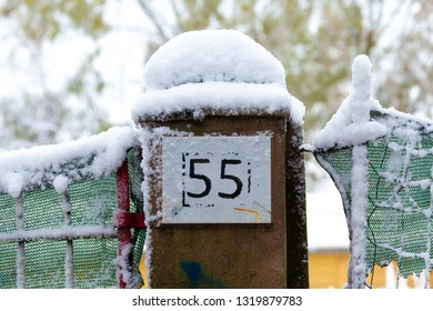 Fifty Five House Number with snow