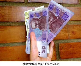 Fifty hryvnia against a brick wall - banknotes of Ukraine fifty hryvnia, Ukraine currency. Ukrainian bill hundred UAH.