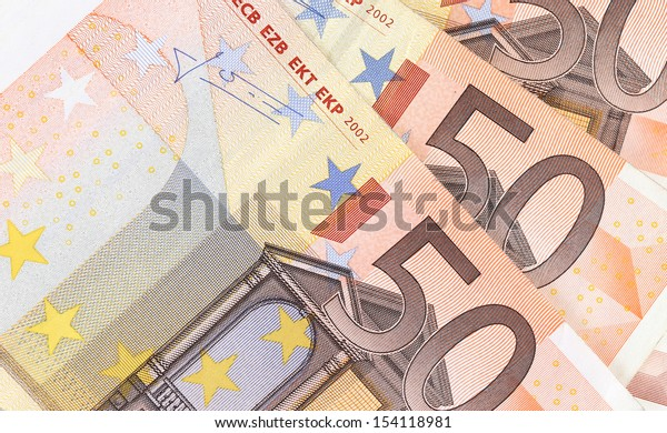 Fifty hundred euro banknotes in a row. close up.