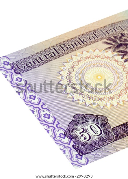 Fifty Iraqi dinars banknote isolated on a white background with focus on the 50.