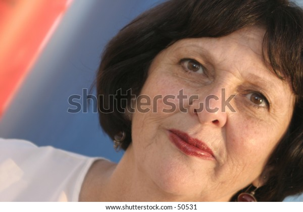 fifty something woman with smiling eyes.