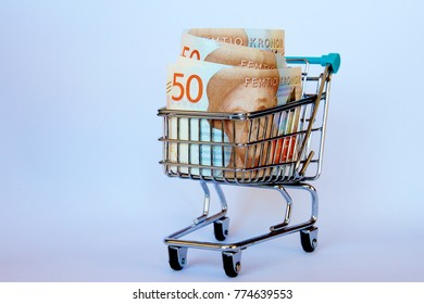 Fifty Swedish kronor notes in a shopping trolley.