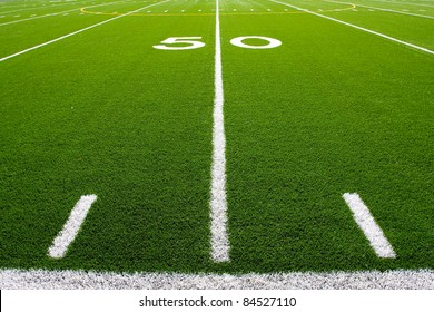 Fifty Yard Line of a Football Field with hashmarks in the foreground