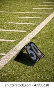 Fifty Yard Line Marker On Sidelines Of Football Field