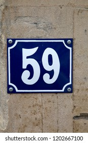 Fifty-Nine Number Sign on Stone Wall