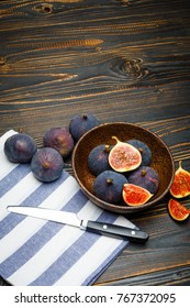 Fig isolated on wooden background