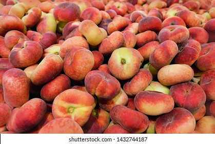fig peach, flat peaches. delicious juicy ripe fig peaches background. fresh tasty peaches fruit at farmers. red mature fig peaches background texture, agricultural products, sale in market. Harvest