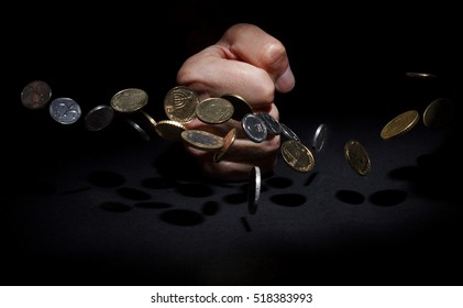The fight against debt. Fist has a desk picking up coins.