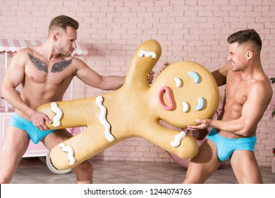 Fight for gingerbread. Two funny guys.