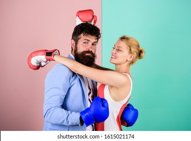 fight for love. Strength and power. bearded man hipster fighting with woman. family couple boxing gloves. knockout punching. who is right. win the fight. problems in relationship. sport.