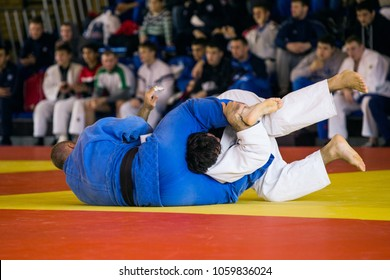 fight on tatami athletes judoists of judo competition