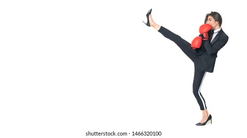 Fighter and Aggressive Business Woman in High Heels Kicking in the Air and in her Hands a Boxing Gloves to Punch , Image with space for copy and advertising on white isolated