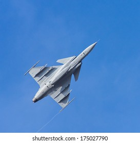 Fighter aircraft on the blue sky