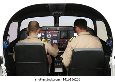 Fighter aircraft simulator training room with two pilots. A flight simulator is a device that artificially re-creates aircraft flight and environment in which it flies, for pilot training, design.