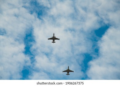 Fighter aircrafts against the background of the blue sky