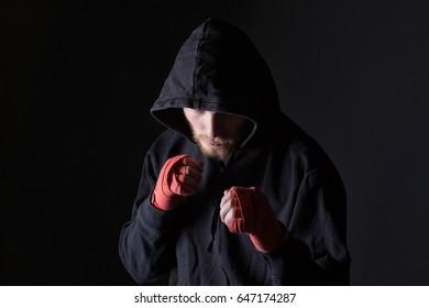 Fighter bearded man wearing hood