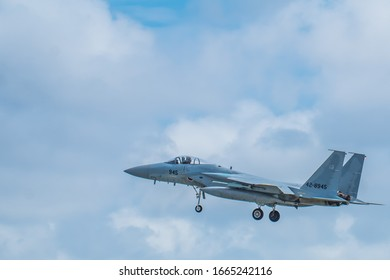 Fighter flying in cloudy sky