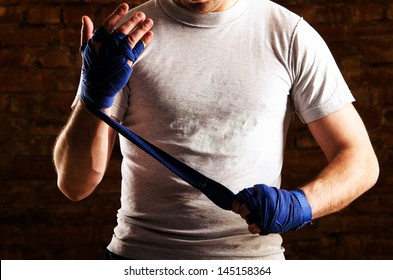 fighter is getting ready against brick wall