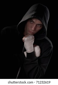 Fighter getting ready for fight, isolated on black