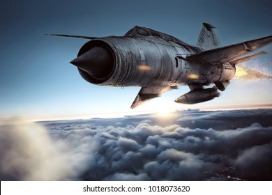 Fighter jet above the clouds