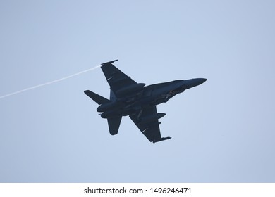 a fighter jet flying in the sky