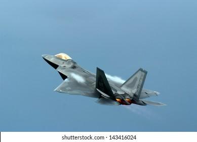 Fighter Jet Plane making Pass through blue sky