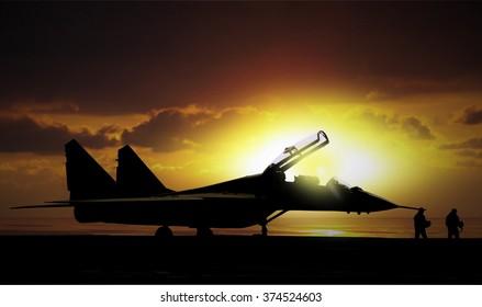 Fighter jet under sunset on super carrier at sea