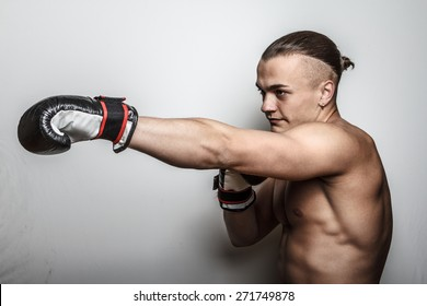 Fighter with naked torso doing exercises