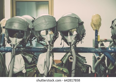 fighter pilot from the swedish air force with his helmet on , Military fighter pilot helmet