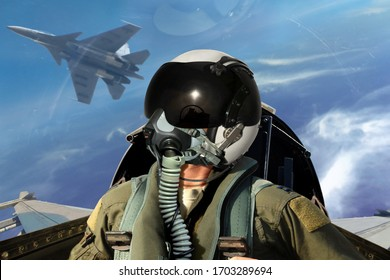 Fighter pilots cockpit view under cloudy blue sky