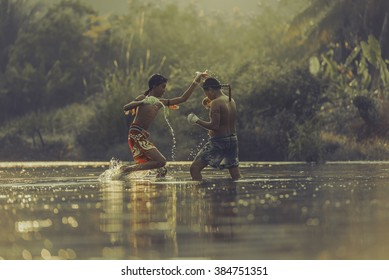 The fighter tying tape around his hand preparing to fight,Thai boxing at the river,Boxing fighters trainning outdoor,Muay Thai