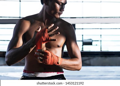 Fighter tying tape before the fight, Thai boxing