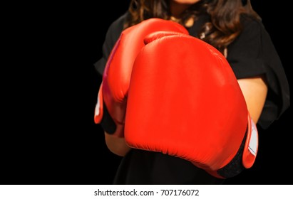 fighter working woman fist close up. straight focus on the glove with the rest of the image on blur.